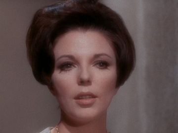 Perhaps do something clever with soft-focus lenses, a la Joan Collins in a 1967 episode of Star Trek. (William Shatner's focus was warts-n-all sharp as a tack.