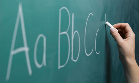 Teacher writing on a blackboard